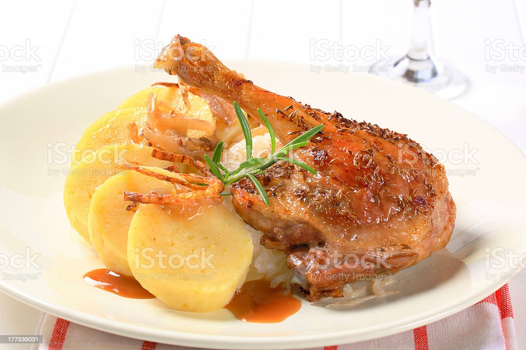 Roast duck with potato dumplings and white cabbage royalty-free stock photo