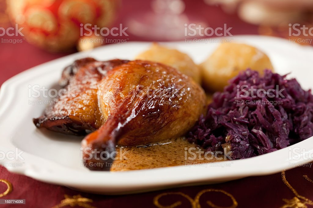 Roast duck with red cabbage and potato dumplings royalty-free stock photo