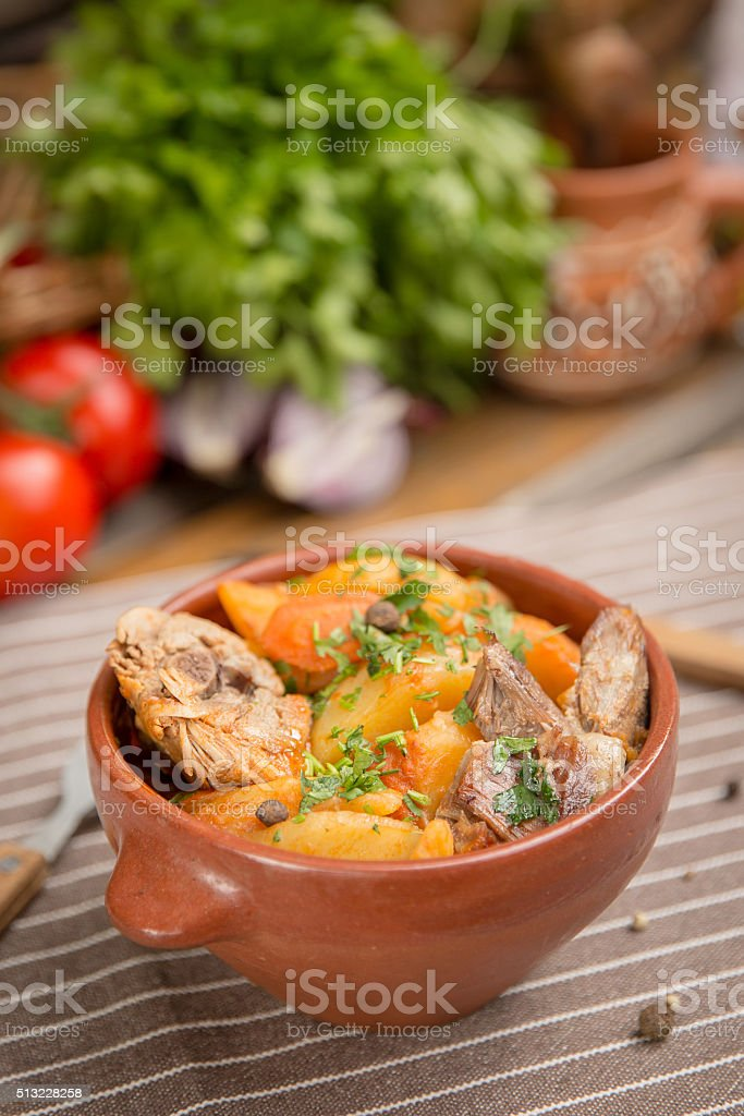 Roast in a pot with beef and vegetables stock photo