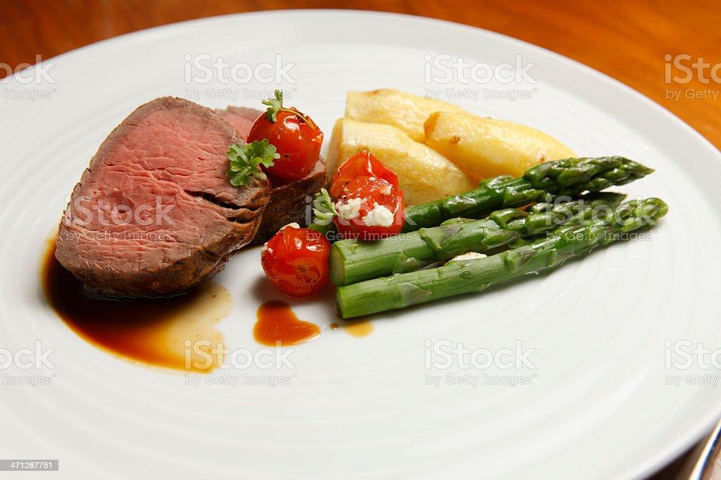 Roast lamb and seasonal vegetables stock photo