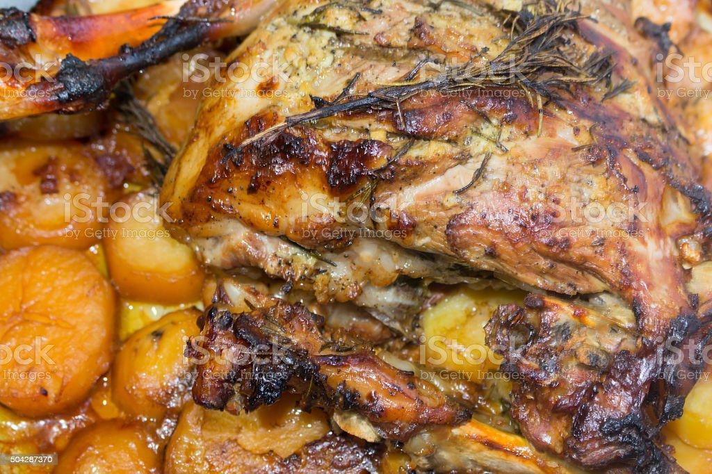 roast leg of lamb with potatoes and rosemary stock photo