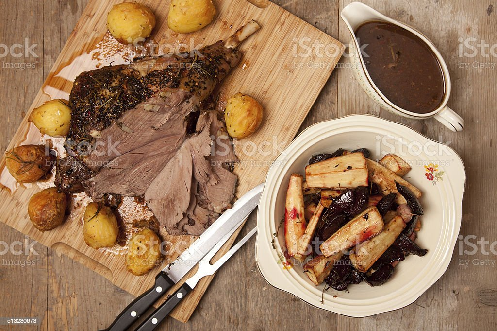 roast leg of lamb with vegetables stock photo