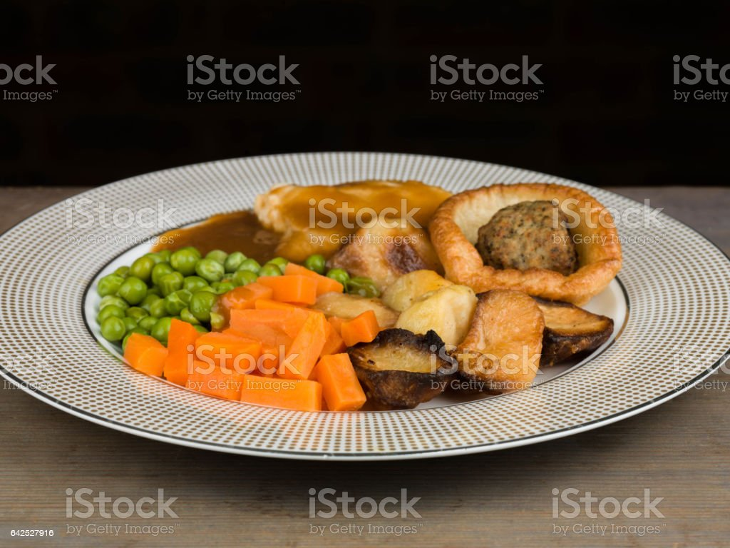 Roast Lunch or Dinner of Roast Chicken With Yorkshire Pudding and Stuffing stock photo