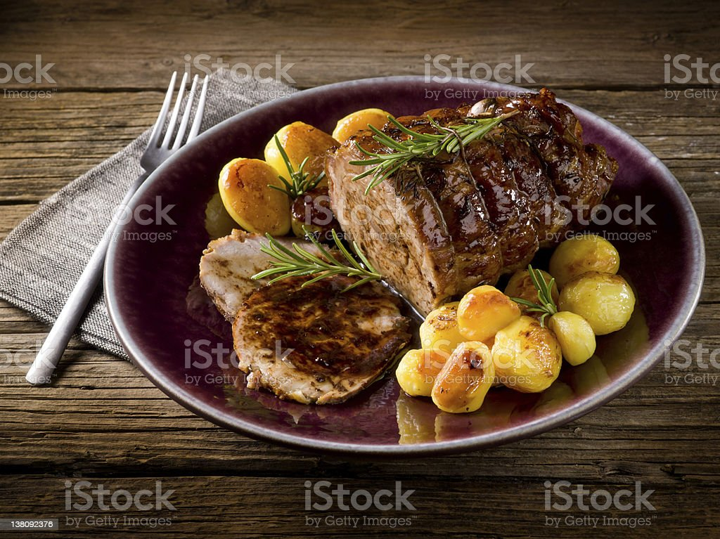 roast of veal with potatoes stock photo