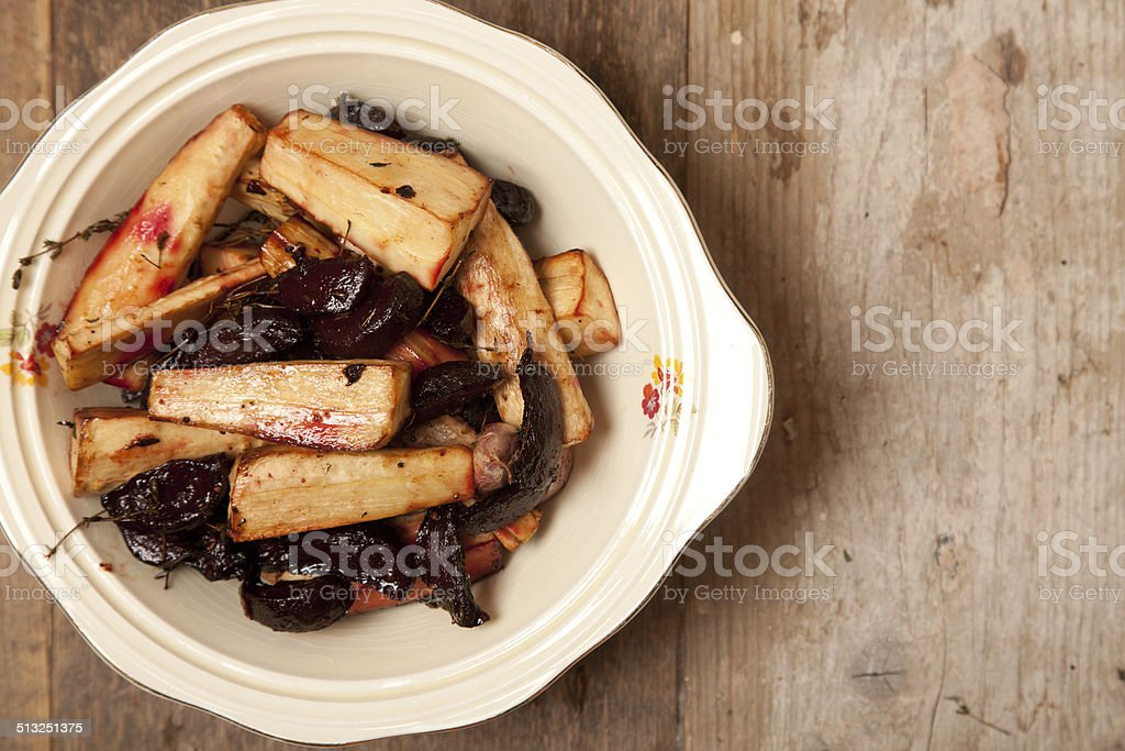 roast parsnips and beetroots stock photo