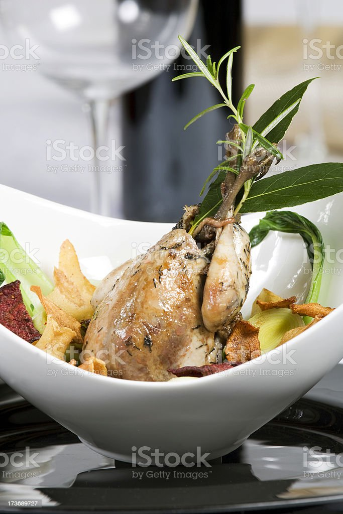 Roast pheasant  with vegetables stock photo