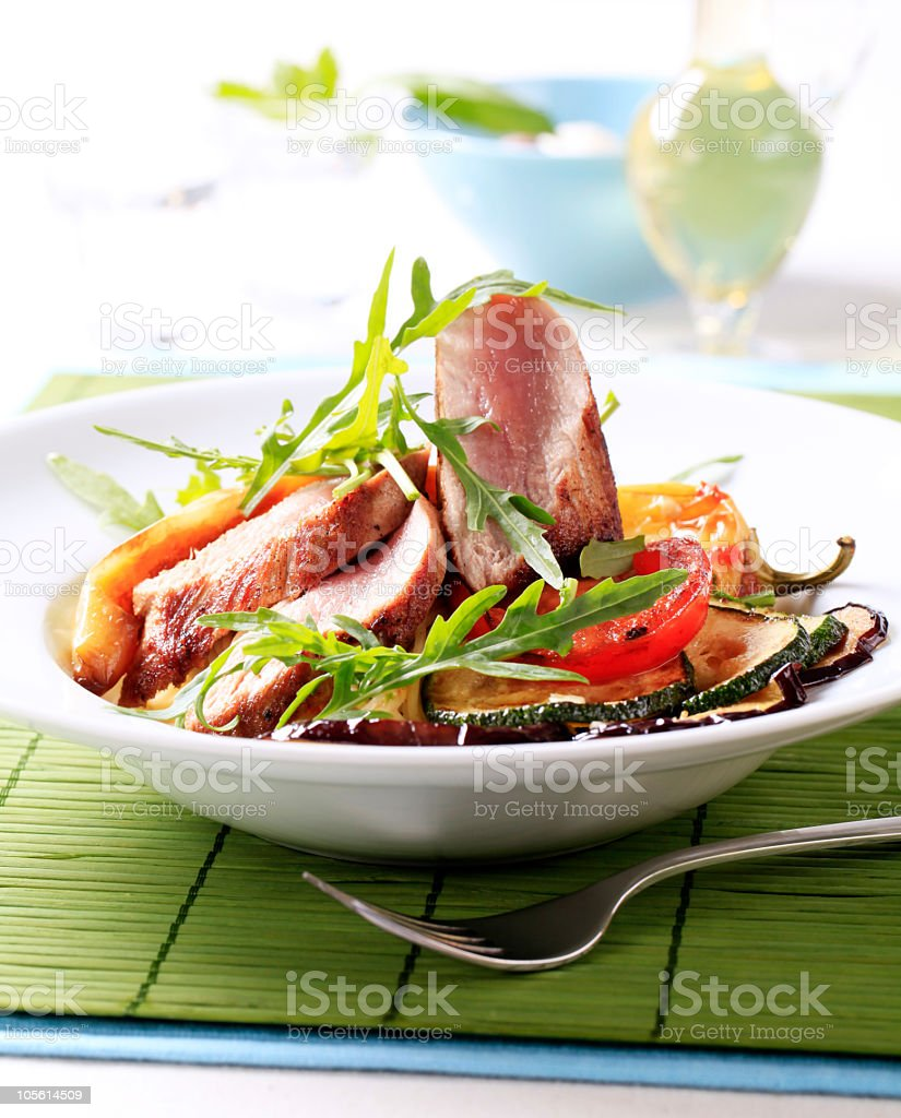 Roast pork and grilled vegetables royalty-free stock photo