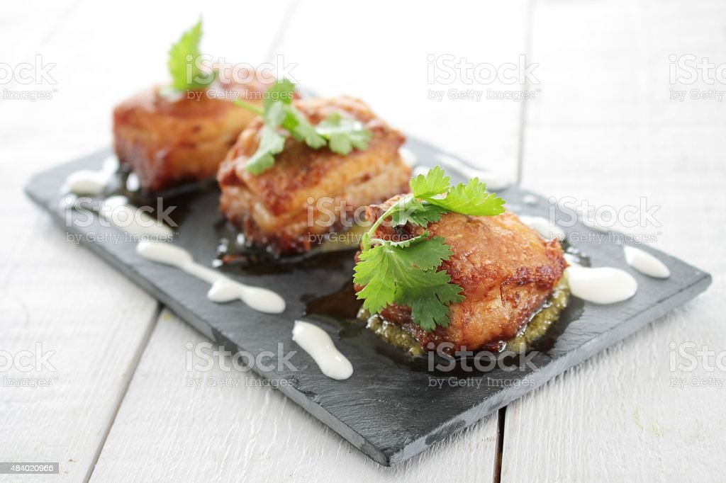 roast pork belly bites stock photo