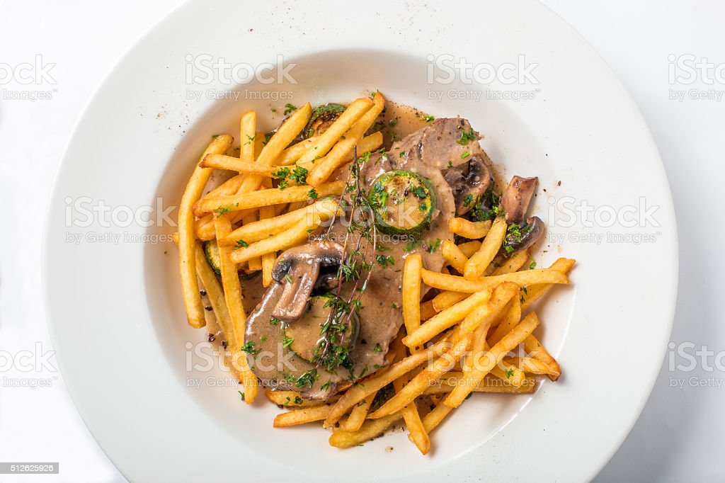 Roast pork on toast with mushrooms, sauce and french fries stock photo