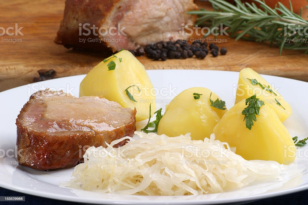 Roast pork with boiled potatoes and sauerkraut royalty-free stock photo
