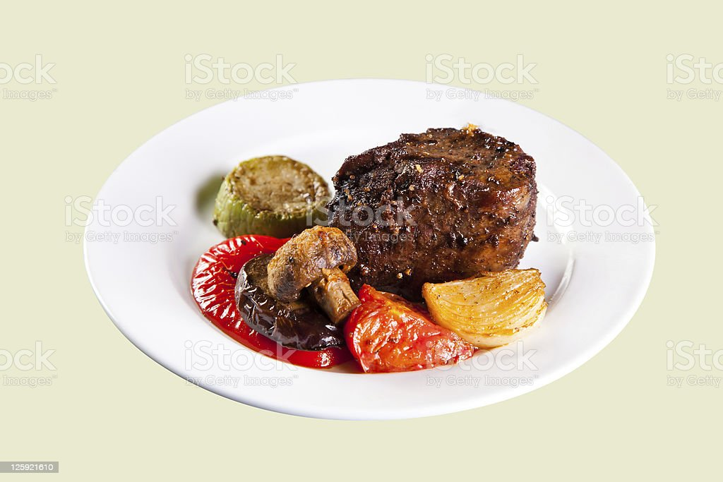 Roast pork with grilled vegetables. Isolated. royalty-free stock photo