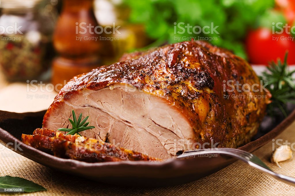 Roast pork with herbs and vegetables. stock photo