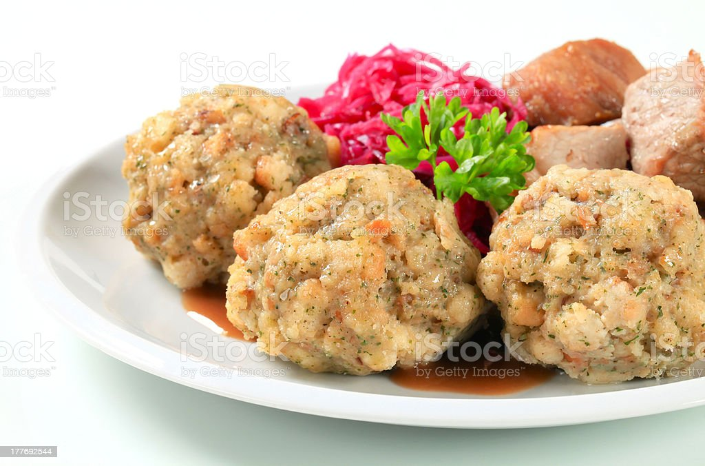 Roast pork with Tyrolean dumplings and red kraut royalty-free stock photo