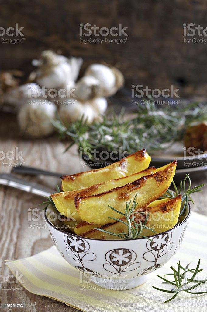 Roast potatoes with rosemary and garlic royalty-free stock photo