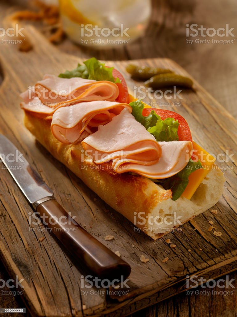 Roast Turkey and Cheese Sandwich on a baguette stock photo