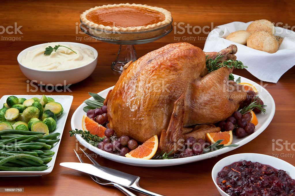 Roast Turkey and Side Dish's on a Cherry Wood Table. stock photo