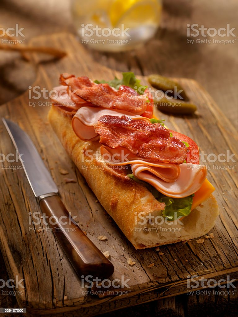 Roast Turkey BLT and Cheese Sandwich on a baguette stock photo