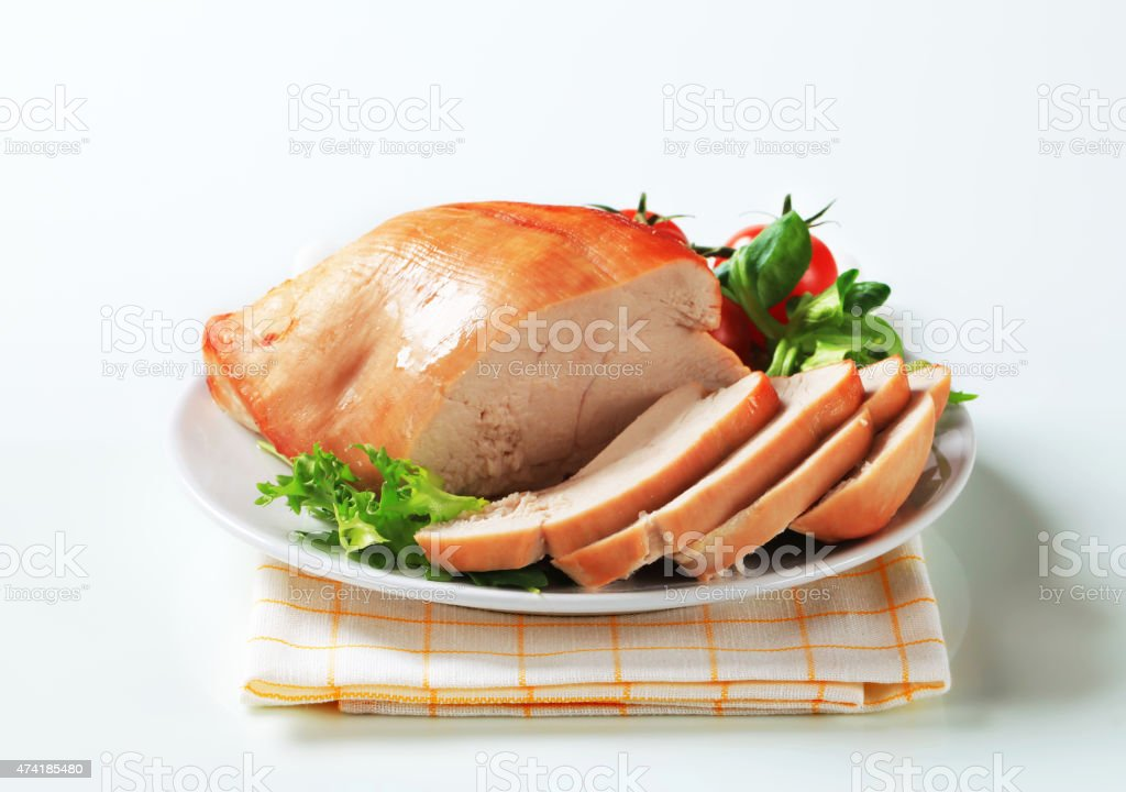 Roast turkey breast on a plate stock photo