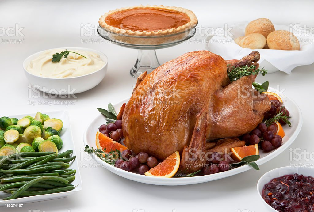Roast turkey served with trimmings on a white table stock photo