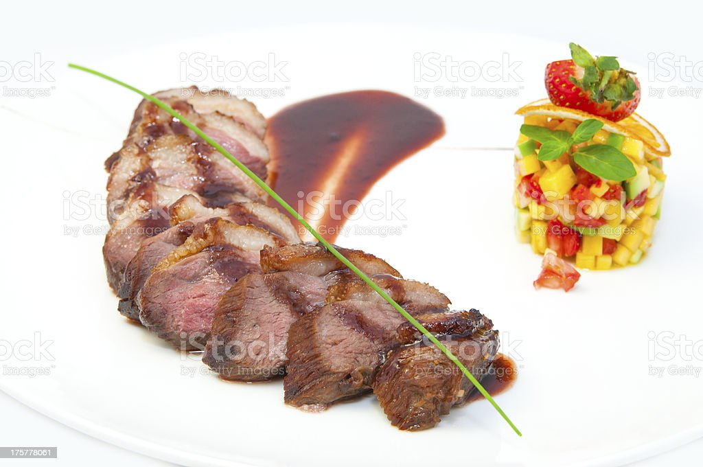 roast venison with vegetable salad and berry sauce royalty-free stock photo