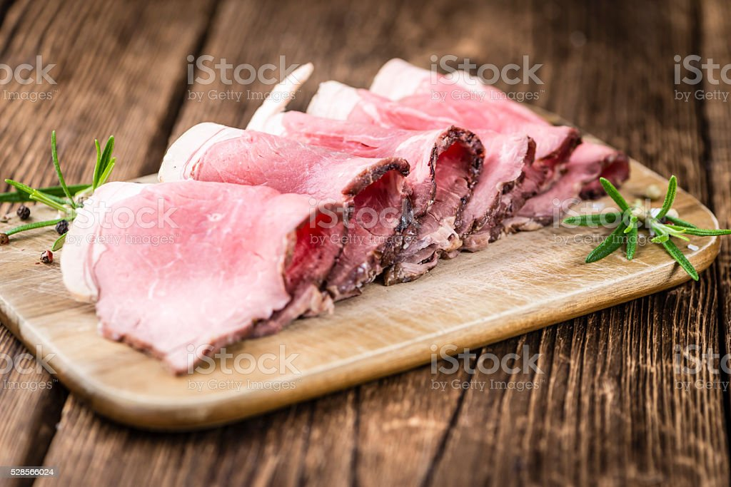 Roastbeef on a wooden table stock photo