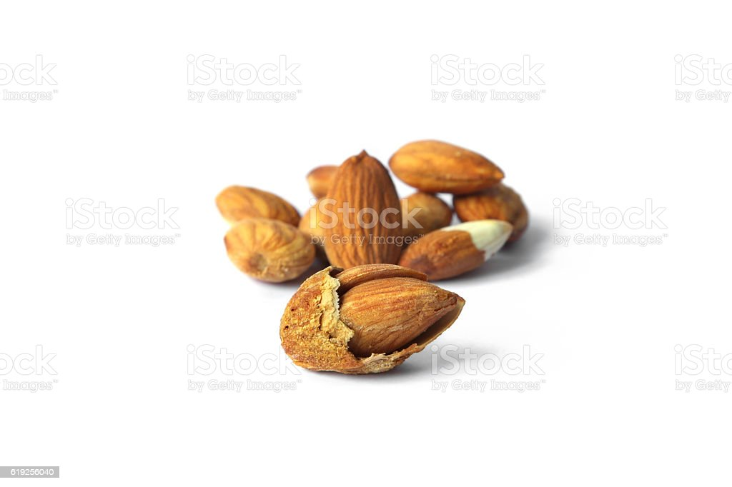 Roasted Almond nut in shell and shelled on white background. stock photo