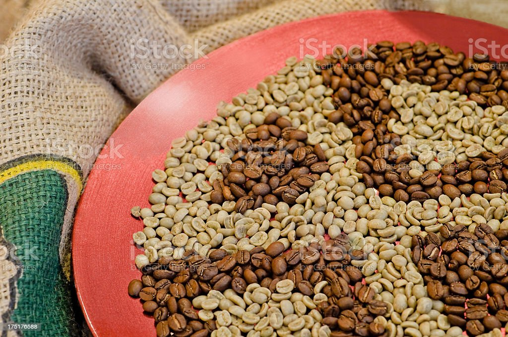 Roasted and natural coffee beans stock photo