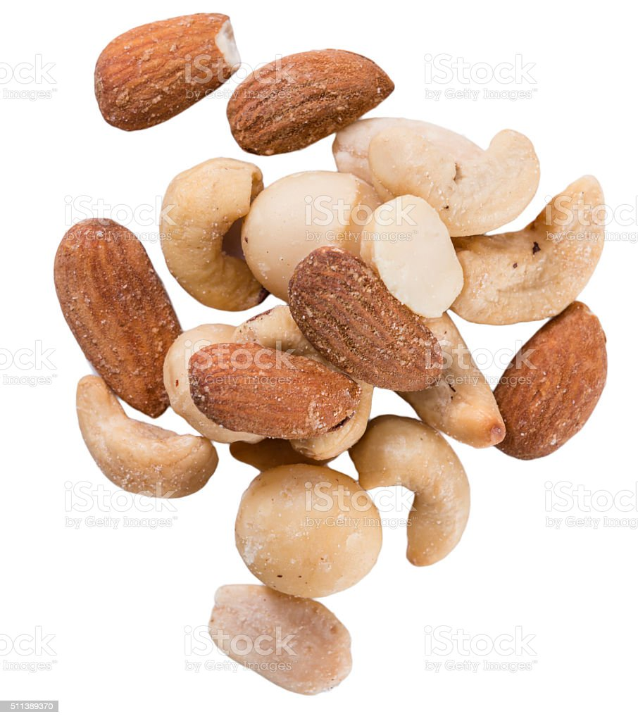 Roasted and salted nuts isolated on white stock photo