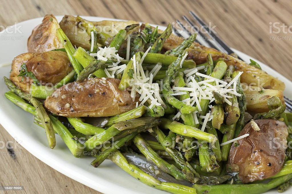 Roasted asparagus and potatoes stock photo
