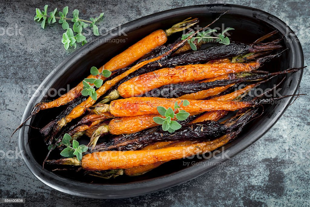 Roasted Baby Carrots Horizontal Overhead View stock photo