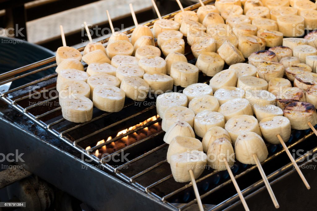 Roasted banana or grilled banana skewer in Asian traditional style. stock photo