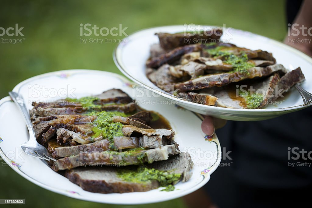 Roasted beef served outside at garden party. royalty-free stock photo