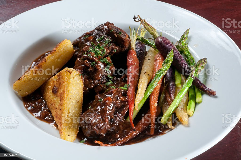 Roasted beef short ribs with vegetables stock photo