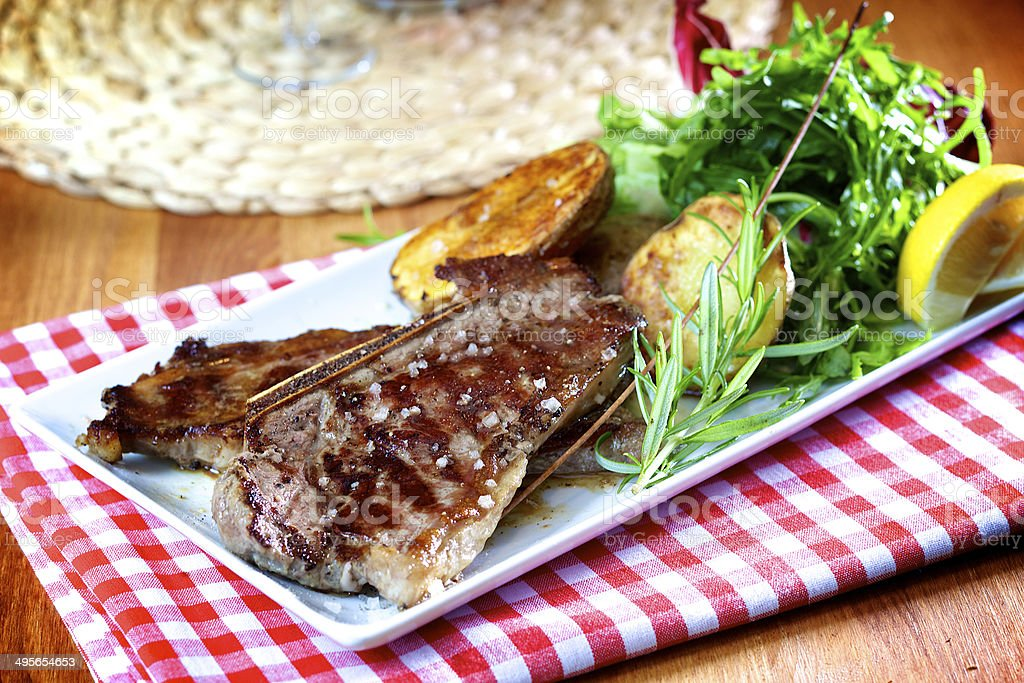 Roasted beef steak with bone royalty-free stock photo