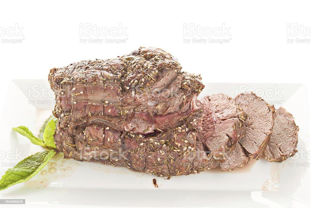 Roasted Boneless Leg Of Lamb On A Plate stock photo