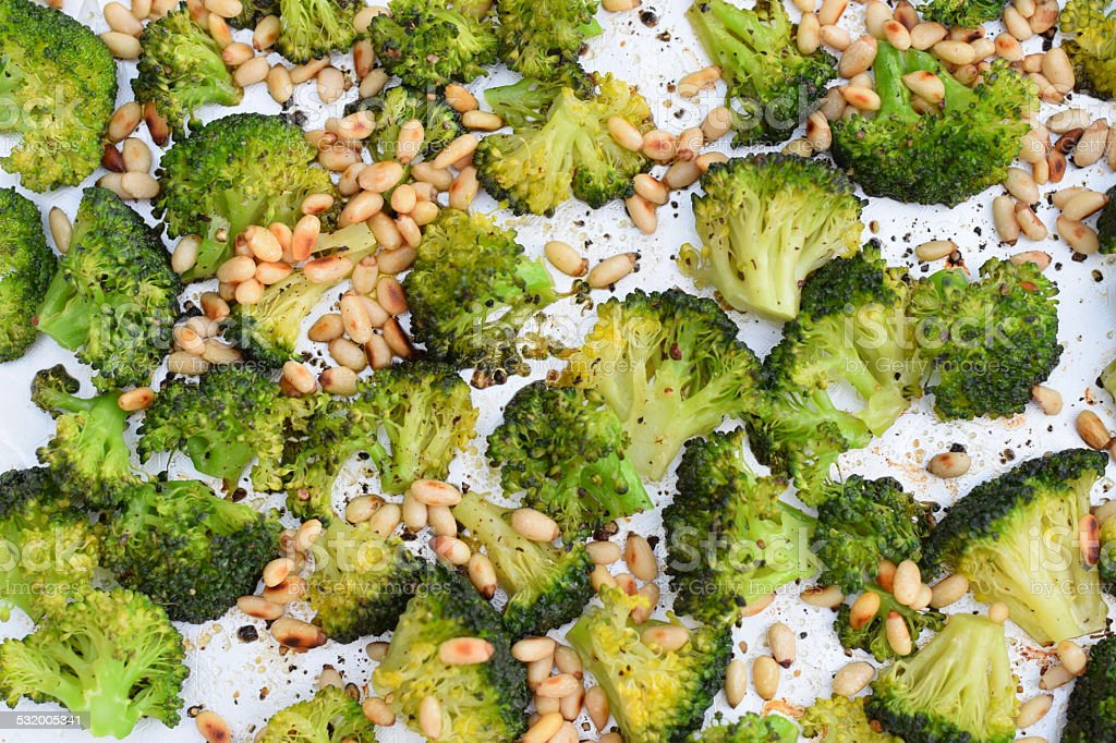 Roasted Broccoli with pine nuts stock photo