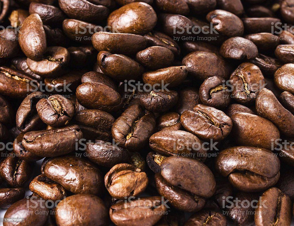 Roasted brown coffee beans  background or texture closeup royalty-free stock photo