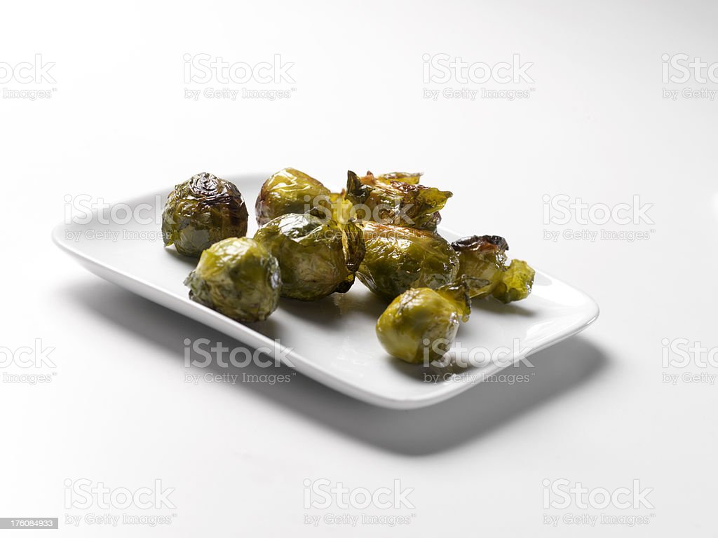 Roasted Brussels Sprouts on White Plate royalty-free stock photo