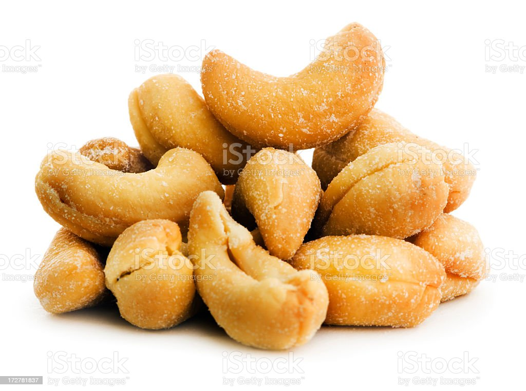 Roasted Cashew Nuts, a Salted Snack Stack Isolated on White royalty-free stock photo