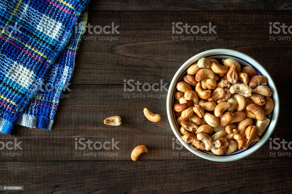 Roasted cashew nuts in a bowl stock photo