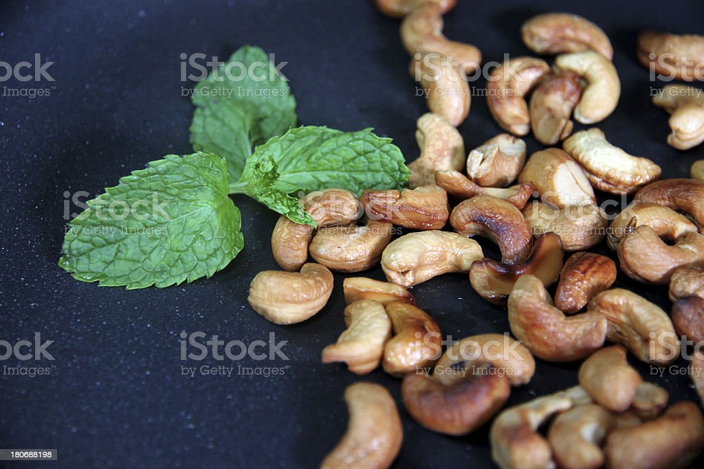 Roasted cashews in the pan. royalty-free stock photo