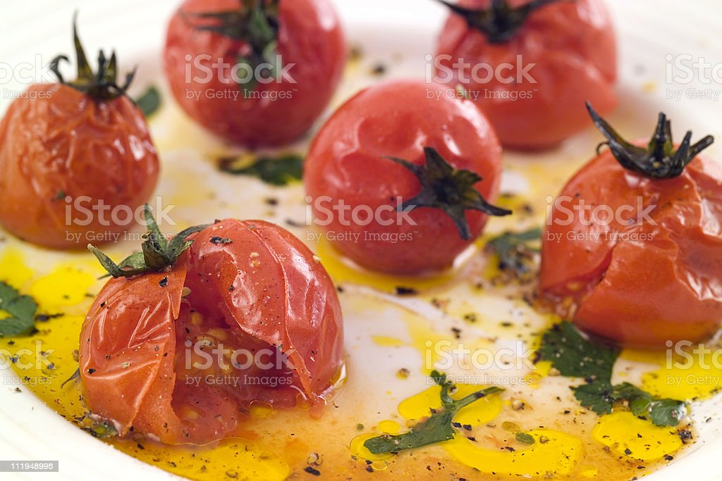 Roasted cherry tomatoes, with herbs and olive oil stock photo