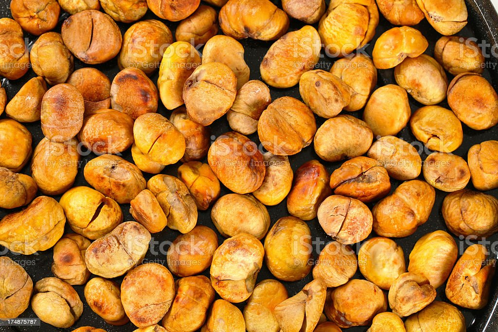 roasted chestnuts background royalty-free stock photo
