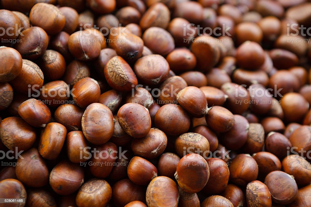 Roasted chestnuts close up. Background. stock photo