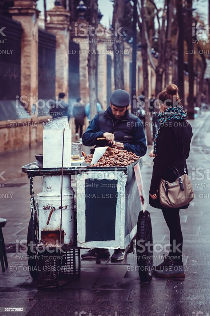 Roasted chestnuts street seller in the city of Seville, Spain stock photo