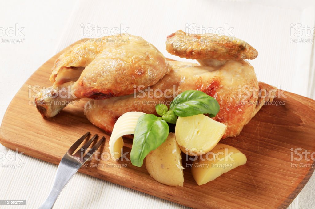 Roasted chicken and new potatoes royalty-free stock photo