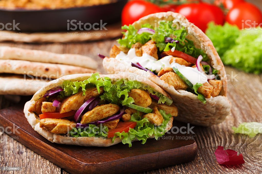 Roasted chicken and vegetables, served in pita. stock photo