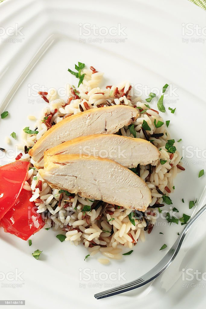 Roasted chicken breast and mixed rice royalty-free stock photo