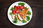 Roasted chicken breast and vegetable salad, top view