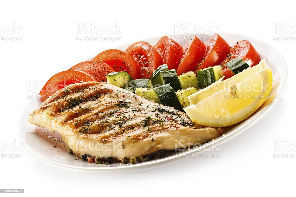 Roasted chicken breast and vegetables royalty-free stock photo